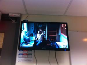 Aaron waving through Skype Wall