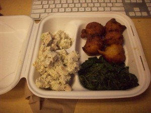 Lunch of DH: apple and goat cheese fritters, wilted spinach, chicken salad